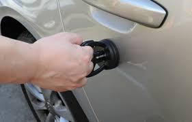 como arreglar la abolladura de tu coche